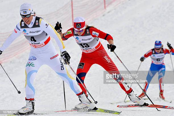 Charlotte Kalla of Sweden and Marthe Kristoffersen of Norway ski during the FIS CrossCountry World Cup Women's 15 km Mass Start on December 18 2010...