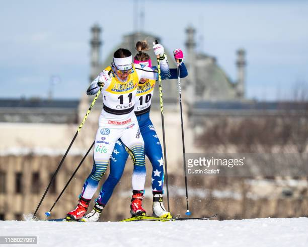 Charlotte Kalla of Sweden and Sadie Bjornsen of the United States competes in the Women's 10km freestyle pursuit during the FIS Cross Country Ski...