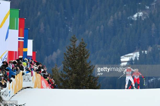 Charlotte Kalla of Sweden and Therese Johaug of Norway compete in the women's Tour de Ski Stage four 15km free pursuit in Toblach on January 3 2013...