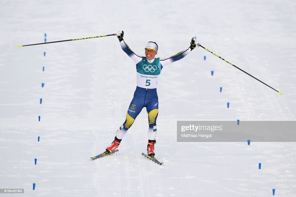 Charlotte Kalla of Sweden celebrates as she crosses the line to win gold during the Ladies Cross Country Skiing 7.5km + 7.5km Skiathlon on day one of the PyeongChang 2018 Winter Olympic Games at Alpensia Cross-Country Centre on February 10, 2018 in Pyeongchang-gun, South Korea.