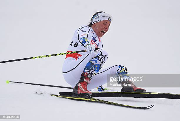 Charlotte Kalla of Sweden celebrates on the way to winning the gold medal during the Women's 10km CrossCountry during the FIS Nordic World Ski...