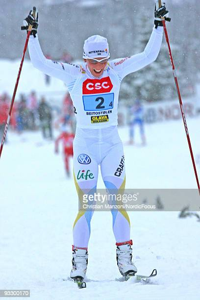 Charlotte Kalla of Sweden celebrates the victory of her team in the Women's 4x5km Cross Country Relay Skiing during day two of the FIS World Cup on...