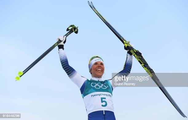 Charlotte Kalla of Sweden celebrates winning gold during the Ladies Cross Country Skiing 75km 75km Skiathlon on day one of the PyeongChang 2018...