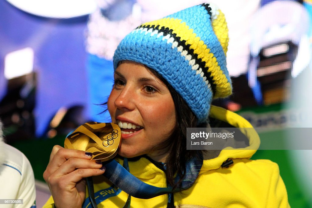 Charlotte Kalla of Sweden celebrates with the gold medal during the medal ceremony for the Cross-Country Skiing Ladies' 10 km Free at Whistler Medals Plaza on day 4 of the 2010 Winter Olympics on February 15, 2010 in Whistler, Canada.