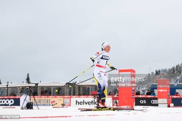 Charlotte Kalla of Sweden crosses the finish line as a winner during the ladies cross country 10K pursuit competition at FIS World Cup Ruka Nordic...