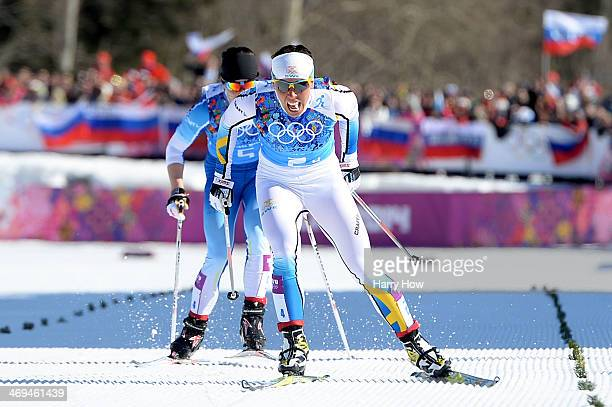 Charlotte Kalla of Sweden crosses the finishing line to win the gold medal in the Women's 4 x 5 km Relay during day eight of the Sochi 2014 Winter...