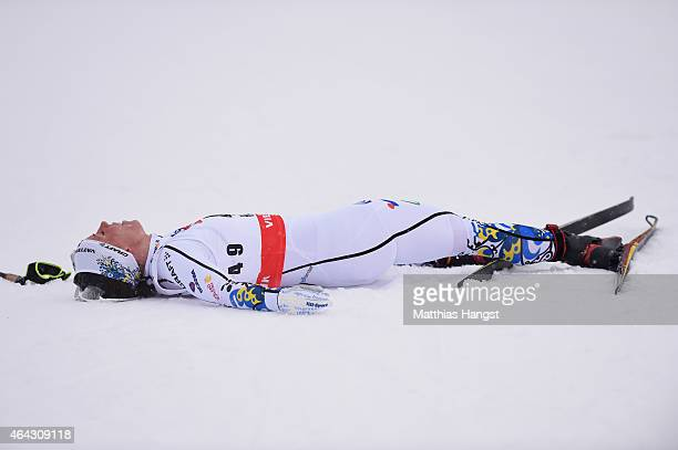 Charlotte Kalla of Sweden lies in the snow on the way to winning the gold medal during the Women's 10km CrossCountry during the FIS Nordic World Ski...