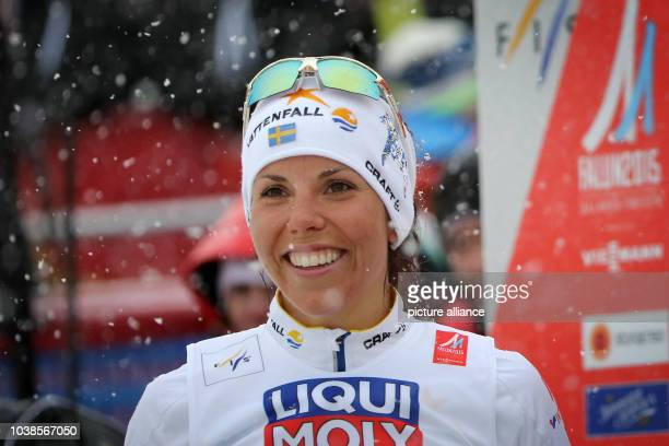Charlotte Kalla of Sweden reacts in the finish during the cross country Women's 10 km Individual Free competition at the Nordic Skiing World...