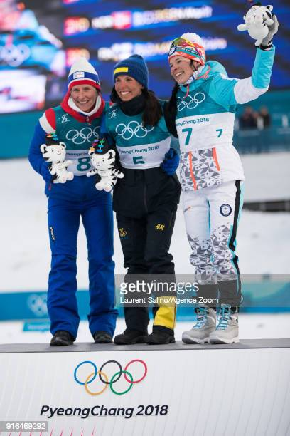 Charlotte Kalla of Sweden takes 1st place Marit Bjoergen of Norway takes 2nd place Krista Parmakoski of Finland takes 3rd place during the...