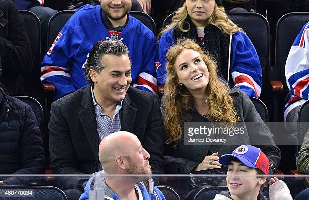 Charlotte Kirk and guest attend New York Rangers vs Carolina Hurricanes game at Madison Square Garden on December 21 2014 in New York City