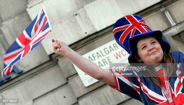 Charlotte Kite from Richmond waits to see the free concert in Trafalger square as crowds fill Central London at 'A Party To Remember' a free concert...