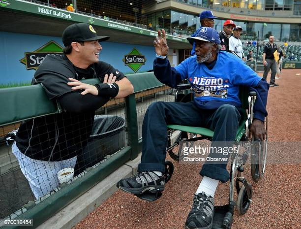 Charlotte Knights catcher Chris O'Dowd left listens as former Negro League pitcher Carl Satch Forney right talks to him about pitching prior to a...
