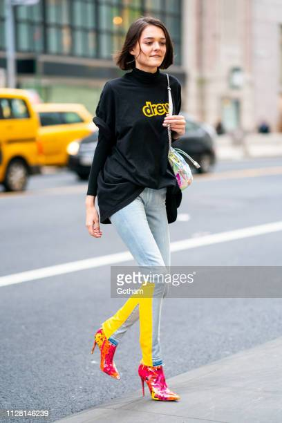 Charlotte Lawrence is seen wearing a Drew House top Off White jeans and Christian Louboutin shoes and in Midtown on February 07 2019 in New York City