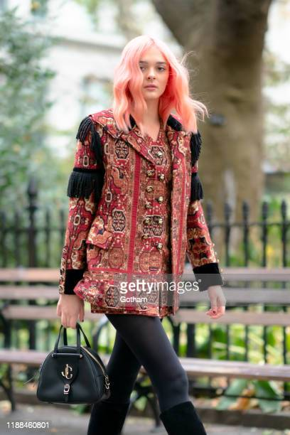 Charlotte Lawrence is seen wearing a Etro jacket and dress with Wolford tights Christian Louboutin shoes and Jimmy Choo handbag in the Flatiron...