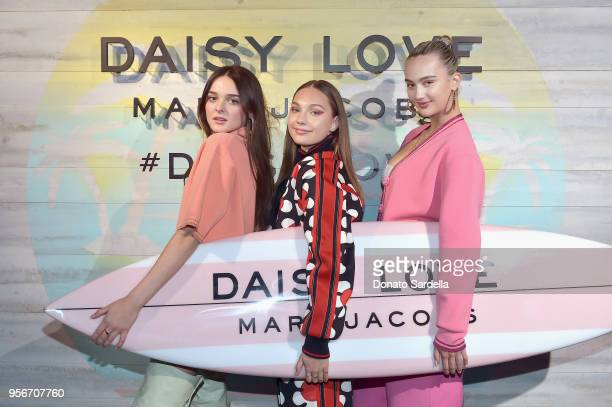 Charlotte Lawrence Maddie Ziegler and Suede Brooks attend the Marc Jacobs Fragrances Celebrates the Launch of DAISY LOVE on May 9 2018 in Los Angeles...