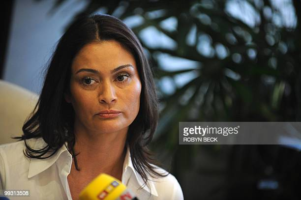 Charlotte Lewis an actress from London listens to her lawyer's statement at a press conference in Los Angeles May 14 2010 Lewis who appeared in Roman...