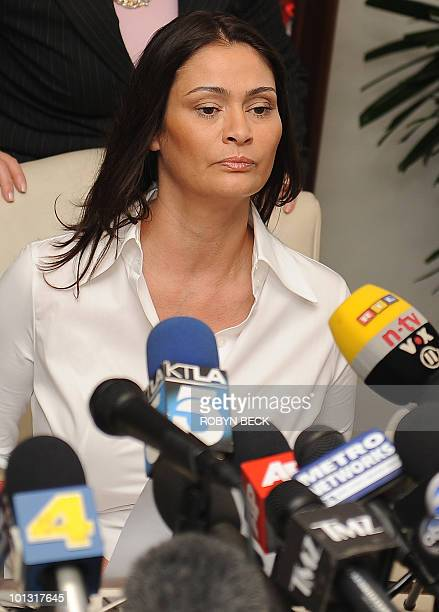 Charlotte Lewis an actress from London takes her seat at the start of her press conference at her lawyer's offices in Los Angeles May 14 2010 Lewis...