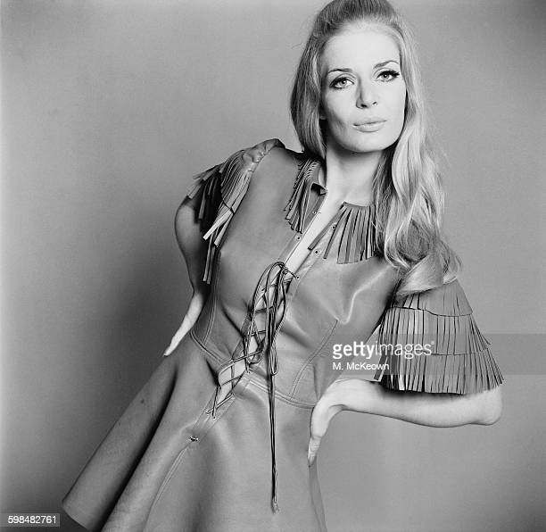 Charlotte Louise models a green leather minidress with a fringe and laced bodice by Ossie Clark UK 15th September 1967