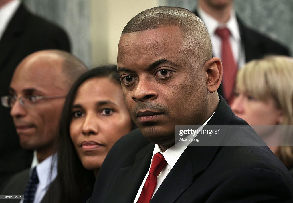 Charlotte Mayor Anthony Foxx and his wife Samara Foxx (C) listen during his confirmation hearing before the Senate Commerce, Science and Transportation Committee May 22, 2013 on Capitol Hill in Washington, DC. Foxx will succeed Ray LaHood to become the next U.S. Secretary of Transportation if confirmed.
