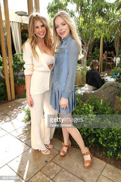 Charlotte McKinney and Charly Sturm during the NetAPorter lunch at hotel Chateau Marmont on February 24 2017 in Los Angeles California
