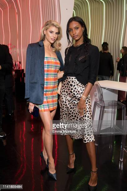 Charlotte McKinney and Jasmine Tookes attend 'STARRING by Ted Gibson' Salon opening on April 10 2019 in Los Angeles California