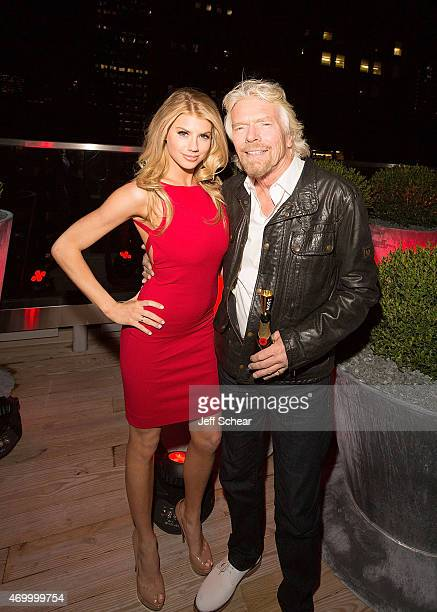 Charlotte McKinney model/actress and Richard Branson Founder of Virgin Group celebrate the Grand Opening of Virgin Hotels Chicago on the rooftop...