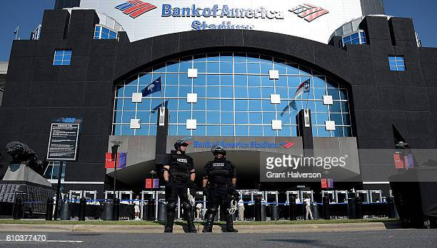 Charlotte Mecklenburg Police Department officers deploy outside of Bank of America Stadium prior to the game between the Carolina Panthers and the...