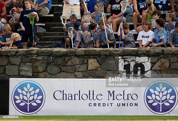 Charlotte Metro Credit Union sign hangs in front of fans enjoying the Florida Launch and Charlotte Hounds lacrosse match at American Legion Memorial...