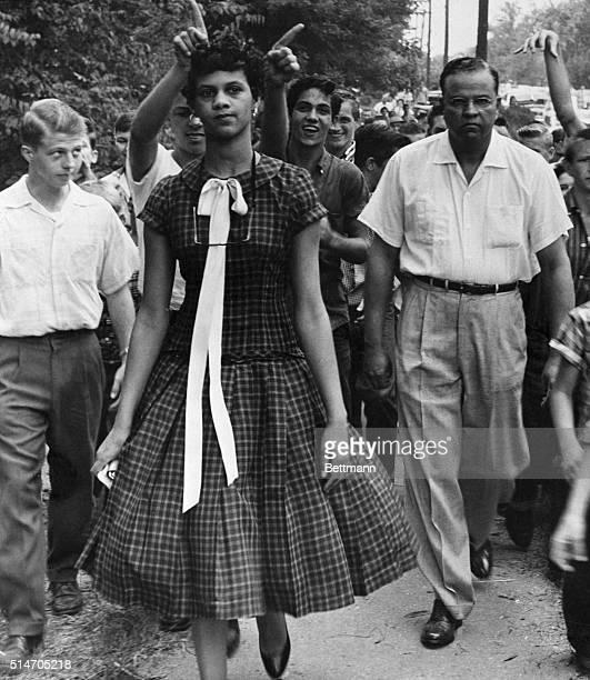 A crowd of youths taunts Dorothy Geraldine Counts as she walks to a previously allwhite Harding High School to enroll Leaving the school she was...