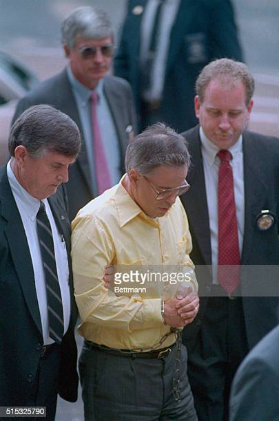 Fallen evangelist Jim Bakker is escorted in handcuffs by federal marshals as he arrived at the Federal Courthouse in Charlotte Bakker was returned to...