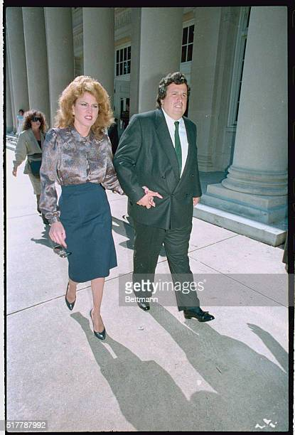 Jessica Hahn leaves the Federal Courthouse holding hands with attorney Dominic Barbara after finishing her testimony before a grand jury Hahn was...
