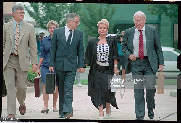 PTL founder Jim Bakker holds the hand of his wife Tammy Faye as the two arrived at the Federal Courthouse in Charlotte The PTL's founder fraud and...