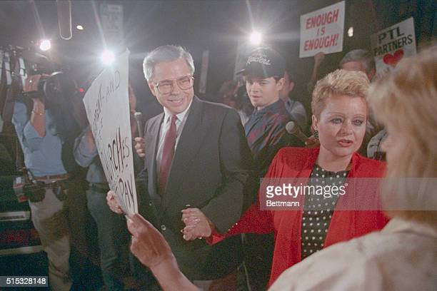 PTL founder Jim Bakker L his son Jamie and wife Tammy Faye Bakker greet supporters as they leave federal court in Charlotte Bakker faces 120 years on...