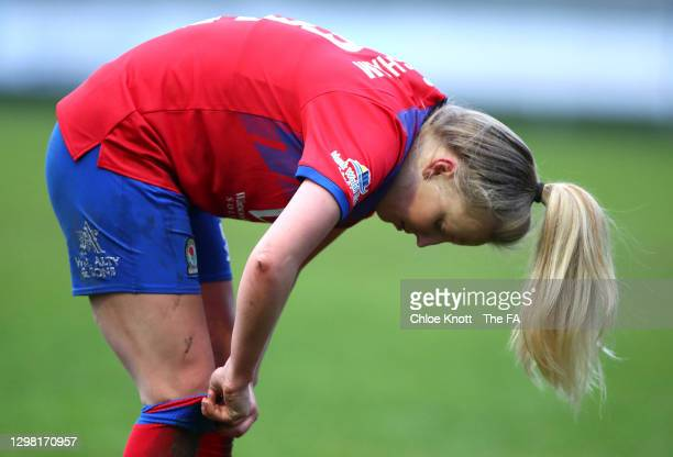 Charlotte Newsham of Blackburn Rovers pulls her socks up after the Barclays FA Women's Championship match between London City Lionesses and Blackburn...
