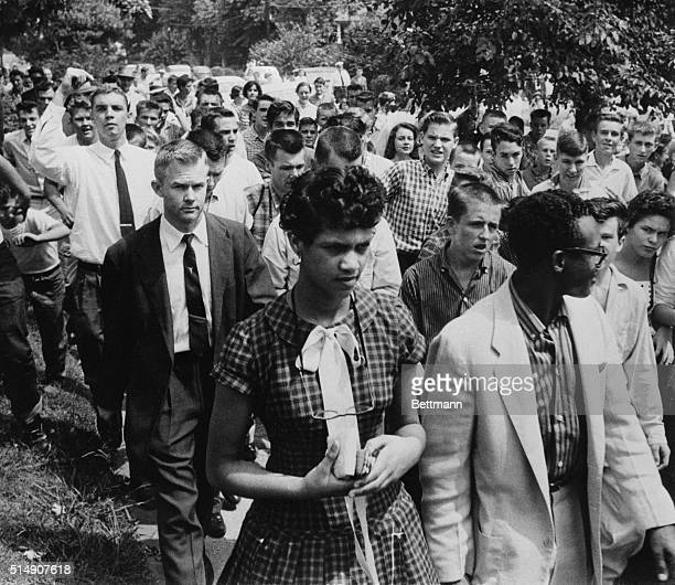 Charlotte, North Carolina: Dorothy Geraldine Counts, 15 is followed by a crowd of jeering teenagers as she leaves Harding high school with her...