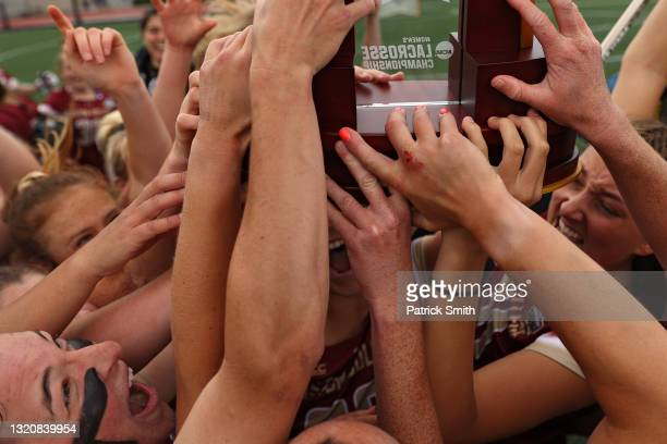 Charlotte North of the Boston College Eagles celebrates with teammates after defeating the Syracuse Orange in the 2021 NCAA Division I Women's...