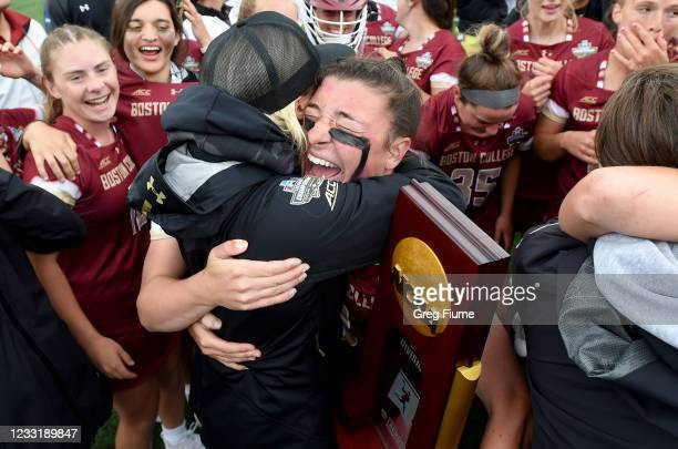 Charlotte North of the Boston College Eagles celebrates with head coach Acacia Walker-Weinstein after winning the Division I Women's Lacrosse...