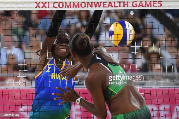 Charlotte Nzayisenga of Rwanda competes during the Beach Volleyball Women's Preliminary round against Linline Matauatu and Miller Pata of Vanuatu on...