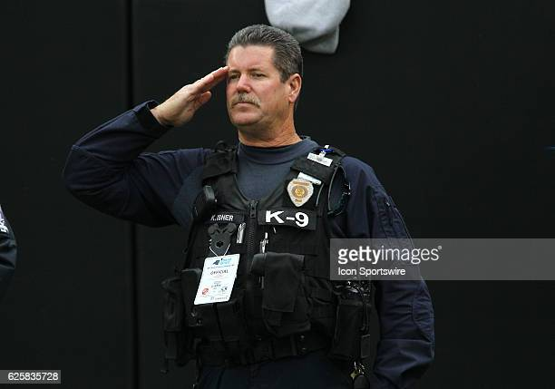 Charlotte Police Officer salutes during the National Anthem of the NFL game between the Kansas City Chiefs and the Carolina Panthers on November 13...