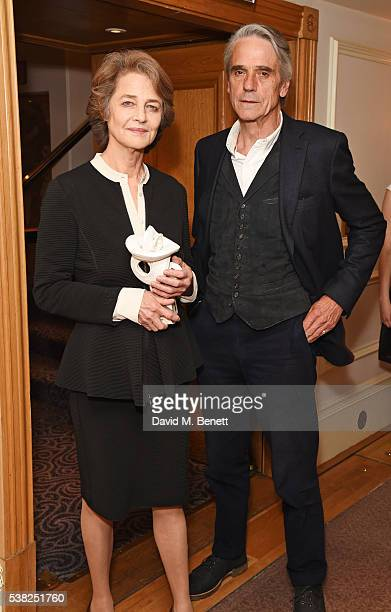 Charlotte Rampling accepting the Film award for '45 Years' and presenter Jeremy Irons pose in the Winner's Room at the The South Bank Sky Arts Awards...