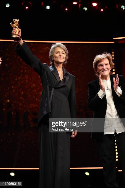 Charlotte Rampling is seen on stage next to Liliana Cavani at the Homage Charlotte Rampling Honorary Golden Bear award ceremony during the 69th...