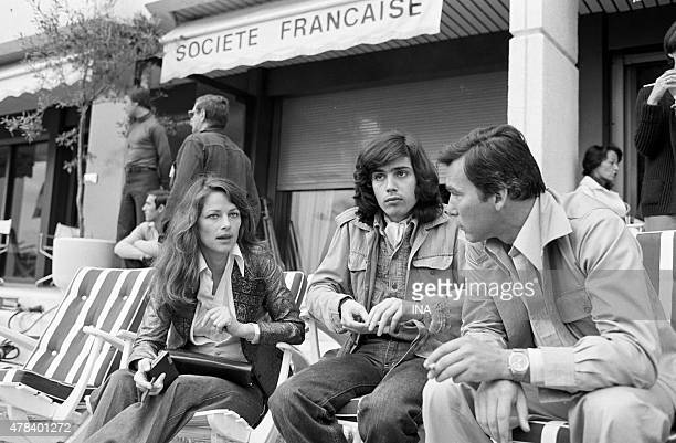 Charlotte Rampling, Jean Michel Jarre and Yves Boisset in front of the lounge of the SFP before a passage in the studio broadcast during the Cannes...