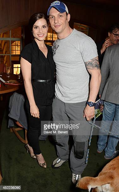 Charlotte Riley and Tom Hardy attend the official launch of the BLAG clothing label at The Club at Cafe Royal on July 16 2014 in London England