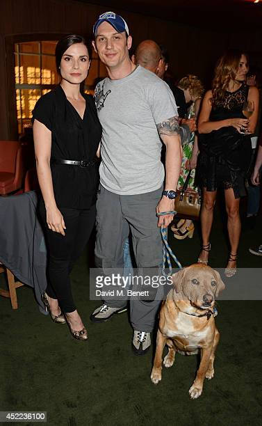 Charlotte Riley and Tom Hardy pose with dog Woody at the official launch of the BLAG clothing label at The Club at Cafe Royal on July 16 2014 in...