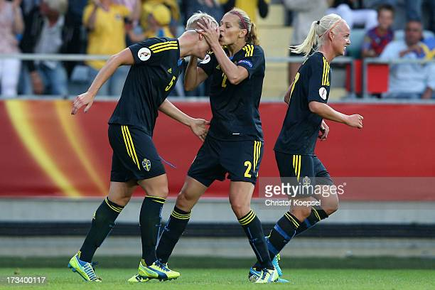 Charlotte Rohlin of Sweden kisses Nilla Fischer of Sweden after she had scored the first goal during the UEFA Women's EURO 2013 Group A match between...