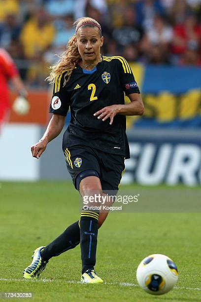 Charlotte Rohlin of Sweden runs with the ball during the UEFA Women's EURO 2013 Group A match between Finland and Sweden at Gamla Ullevi Stadium on...