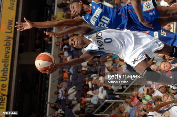Charlotte SmithTaylor of the Washington Mystics goes for a layup against Shameka Christon of the New York Liberty during a WNBA game on June 1 2005...