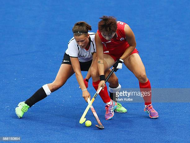 Charlotte Stapenhorst of Germany and Eeseul Baek of Korea battle for the ball during the Women's Pool B Match between Germany and Korea on Day 5 of...