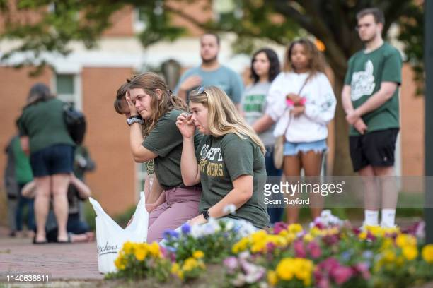 Charlotte students participate in a vigil on campus where the previous day a gunman killed two people and injured four students on May 1, 2019 in...