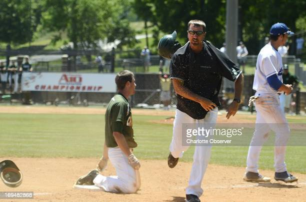 Charlotte third base coach Kris Rochelle flings his helmet after the 49ers' Shane Basen was called out at the bag during the first game of the A10...